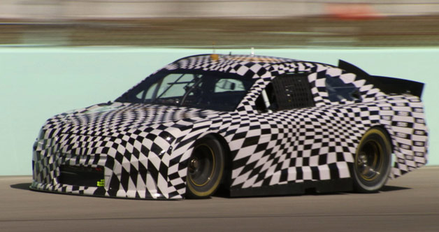 Chevrolet SS racecar prototype in checkerboard disguise at speed
