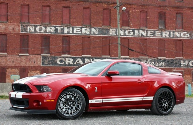 2013 Ford Shelby GT500 coupe in red candy metallic - front three-quarter view