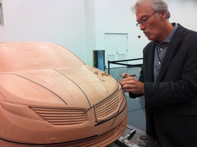 Lincoln designer works with 2013 MKZ clay scale model