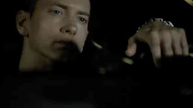 Screencap with Eminem driving Chrysler 200 from