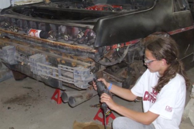 Fourteen-year old Kathryn DiMaria works on her Pontiac Fiero