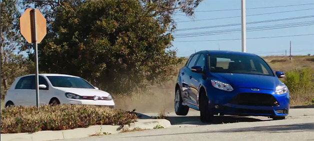 2013 Ford Focus ST racing 2013 VW GTI around abandoned neighborhood - video screencap