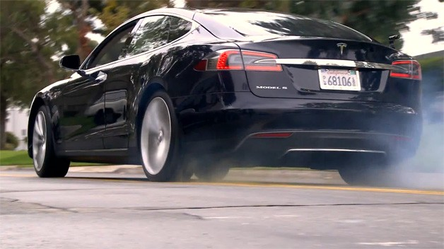 Jay Leno burns rubber in black Tesla Model S