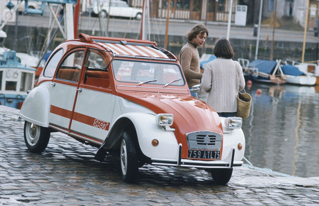 Citroen 2CV in two-tone in cobblestoned harbor
