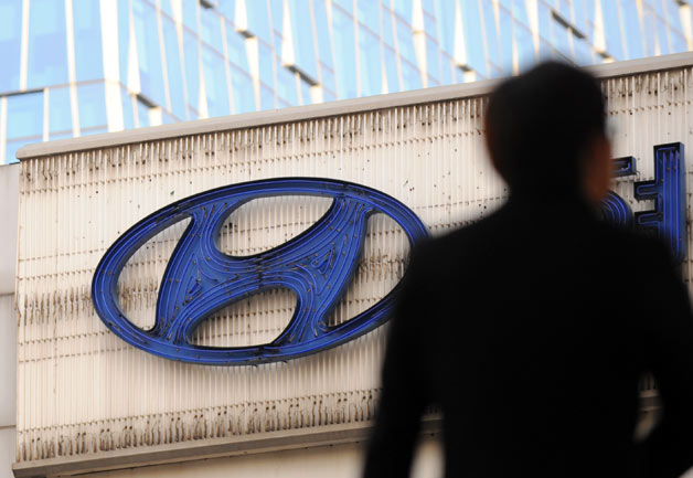 Hyundai sign with shadowy figure