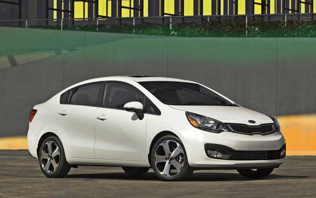 2012 Kia Rio sedan - front three-quarter view, white