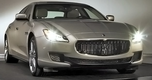 2013 Maserati Quattroporte - front three-quarter view with lights on