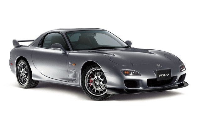 Mazda RX-7 in silver - front three-quarter studio view