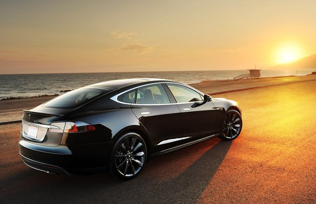 Tesla Model S - black - rear three-quarter view at sunset