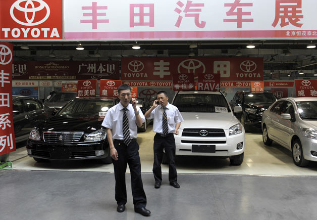 Toyota Beijing dealership with salesmen out front
