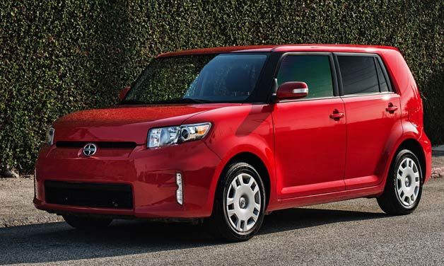 2013 Scion xB - front three-quarter view, red