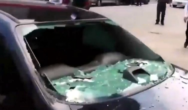 Brazilian lady destroys intrigue husband's automobile in public