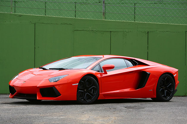 2012 Lamborghini Aventador - front three-quarter view against green wall
