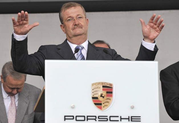 Former Porsche CEO Wendelin Weideking at podium with arms up