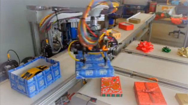 GM robots gift wrapping presents for the holidays - video screencap