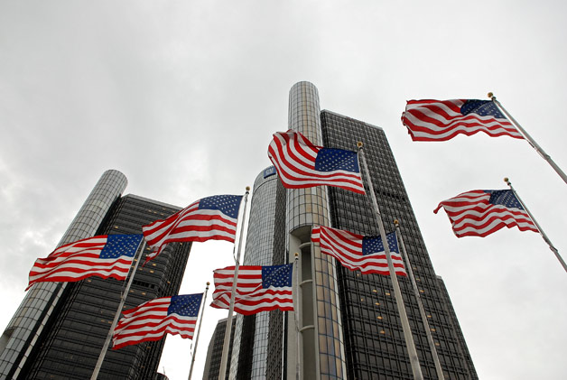 General Motors Renaissance Center headquarters with American flags