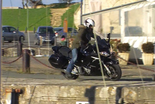 motorcyclist rides off pier
