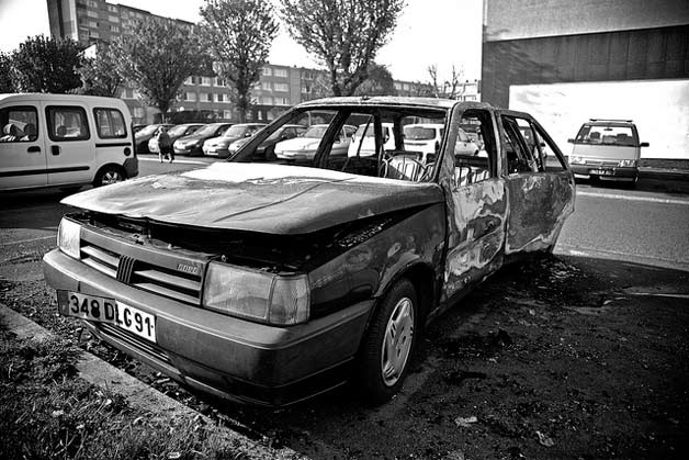 Torched Fiat sits in French parking lot