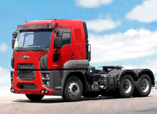 2013 Ford Cargo Extra Heavy-Duty big rig - front three-quarter view, red