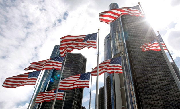 GM Renaissance Center with flags