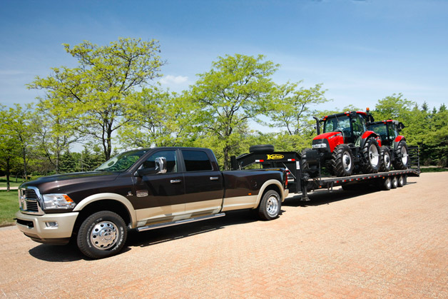 2013 Ram 3500 Heavy Duty towing trailer with tractors