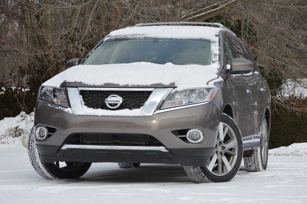 Snow-covered 2013 Nissan Pathfinder long-term vehicle - front three-quarter view