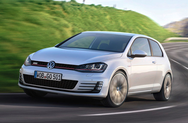 2014 Volkswagen GTI - front three-quarter dynamic view, white