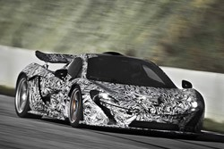 McLaren P1 - running with camouflage - front three-quarter view