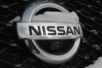 Snow-covered Nissan badge on long-term 2013 Pathfinder
