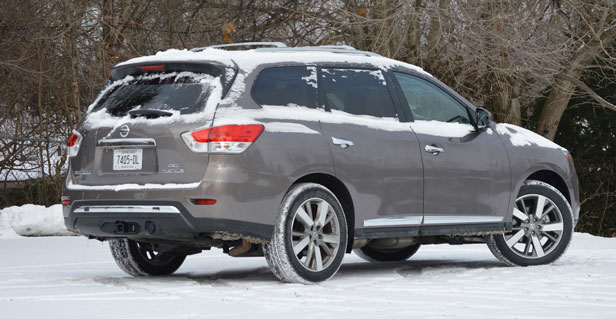Snow-covered 2013 Nissan Pathfinder long-term vehicle - rear three-quarter view