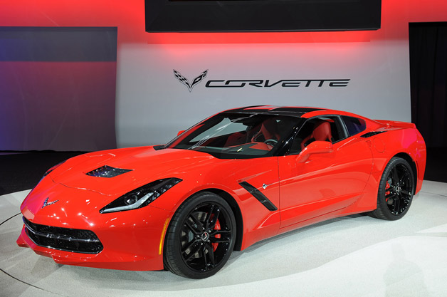 2014 Chevrolet Corvette Stingray on show stand - front three-quarter view, red