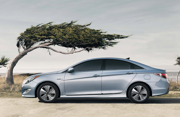2013 Hyundai Sonata Hybrid with windswept trees