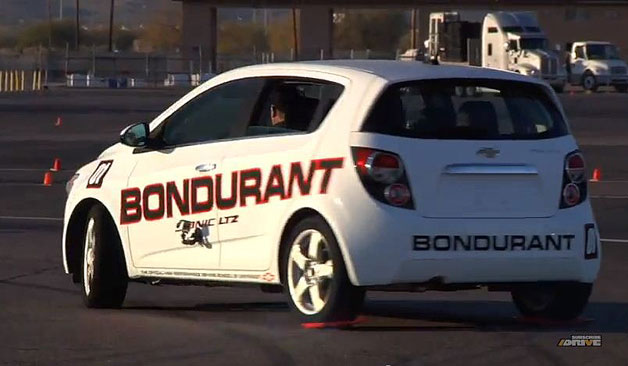 Bob Bondurant driving school Chevy Sonic LTZ drifting on lunch trays - video screencap