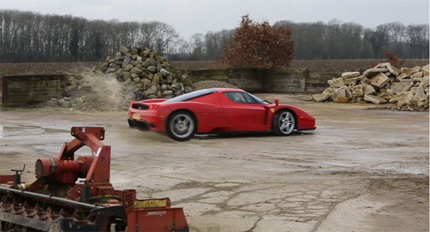 Ferrari Enzo hooning it up in a rock pile yard - video screencap