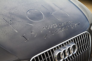 Audi Allroad covered in dust at King of the Hammers 2013 - writing on hood