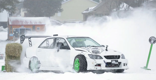 Drifting upon the solidified lake with the studded Lexus looks similar to fun