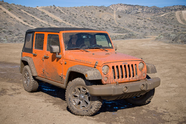2013 Jeep Wrangler Unlimited Rubicon covered in mud