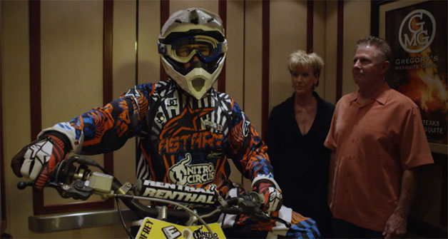 Tanner Godfrey of Nitro Circus rides in elevator with his motocross bike - video screencap