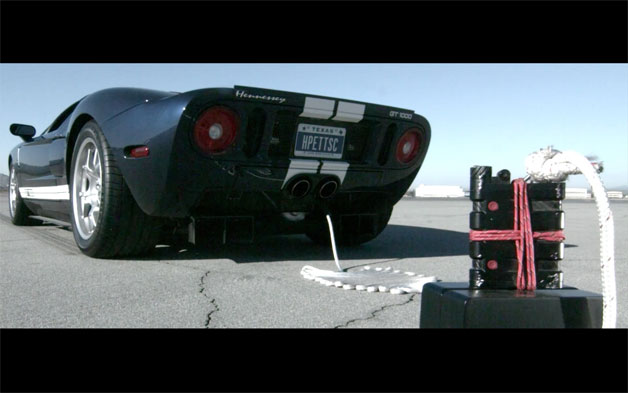 Black Ford GT tethered to Oakley / Macallan flask - video screencap