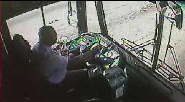 In-bus footage of Broward County bus driver eating and driving - video screencap