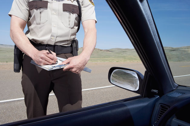 Officer writing traffic ticket