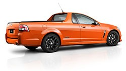 Holden VF Commodore Ute - rear three-quarter view - orange