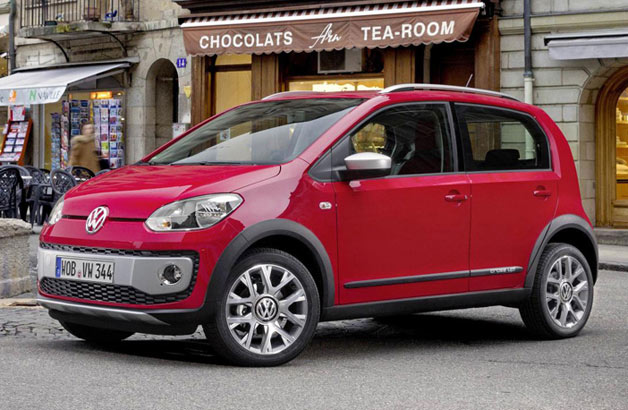 2013 Volkswagen Cross Up!  - front three-quarter view in city setting