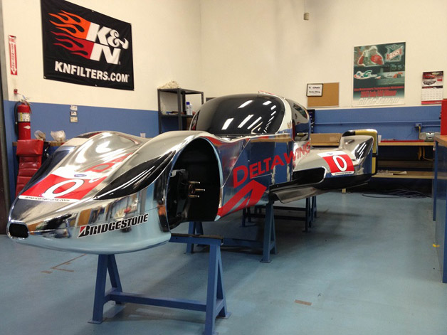 DeltaWing Coupe chassis in garage, wheels off