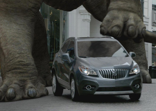 2013 Buick Encore with dinosaur feet in first ad - video screencap