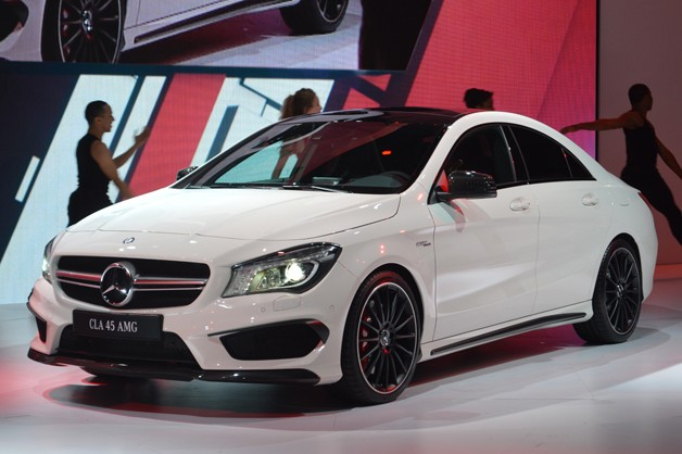 2014 Mercedes-Benz CLA45 AMG - front three-quarter view - white - live on stage at 2013 NY Auto Show