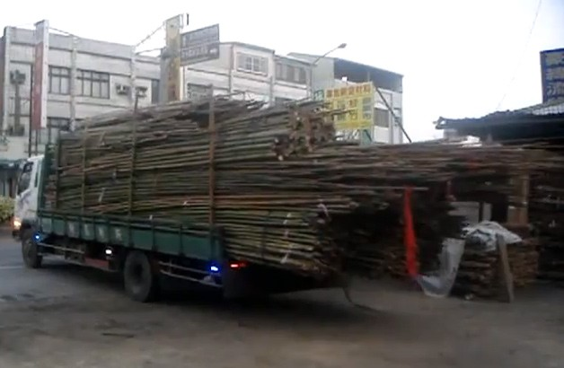 Truck unloading bamboo - video screencap