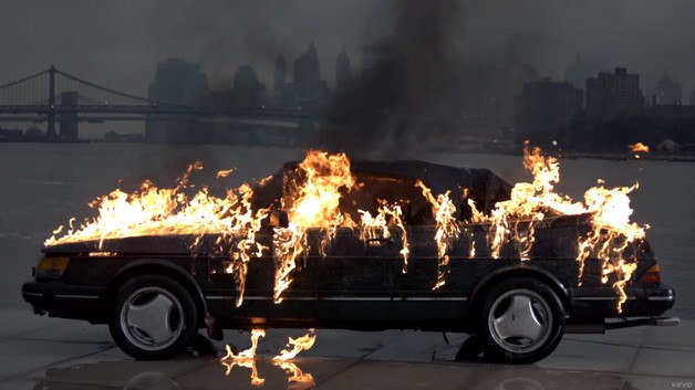 Vampire Weekend torches Saab 900 Convertible for music video - screencap