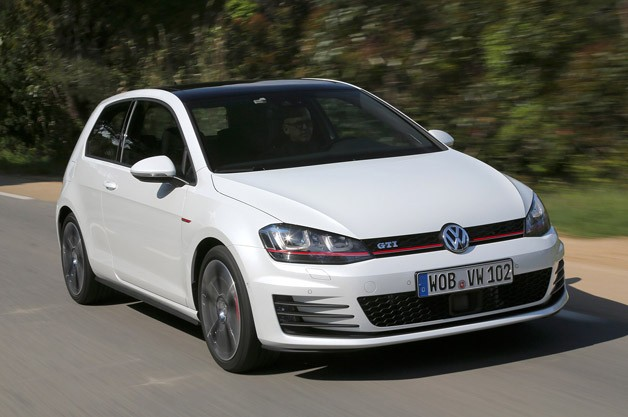 2015 Volkswagen Golf GTI - front three-quarter view, in motion