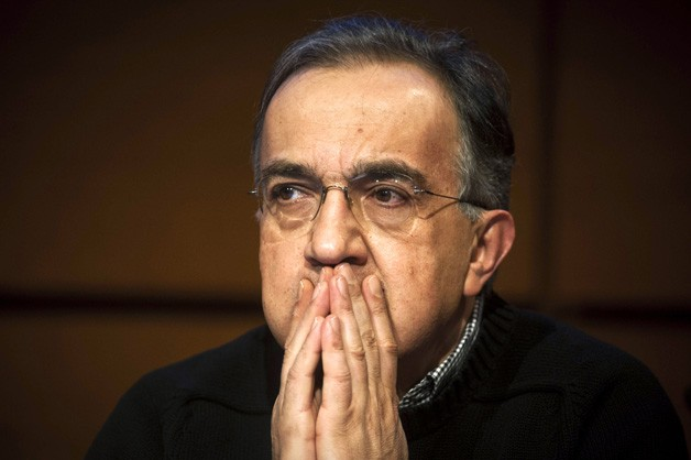 Fiat-Chrysler CEO Sergio Marchionne with hands on face